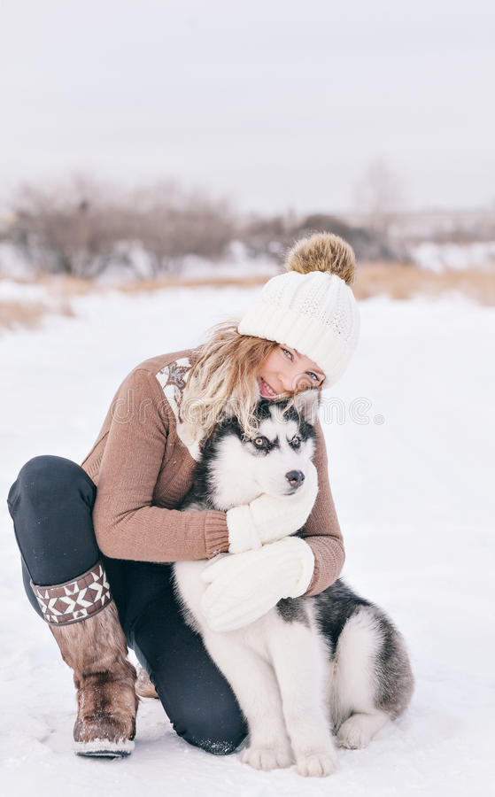 Woman embracing with a pup stock photos