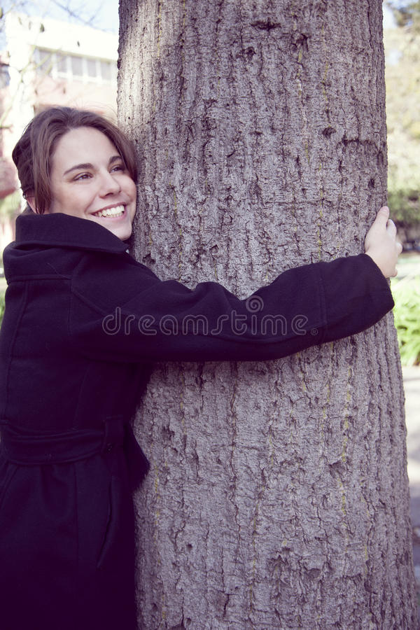 Woman embracing tree royalty free stock images