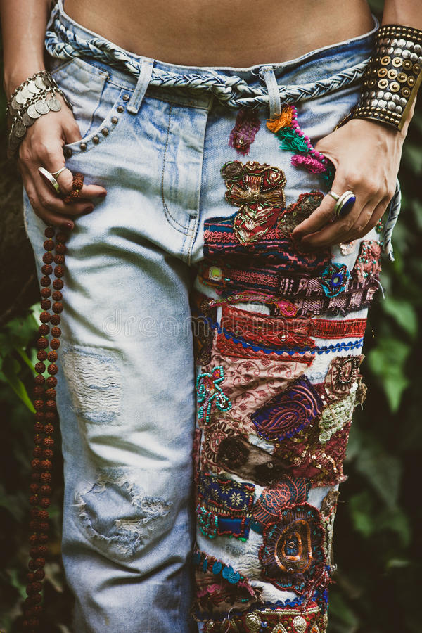 Woman in embroidered jeans. Closeup of woman in embroidered jeans in boho style royalty free stock images