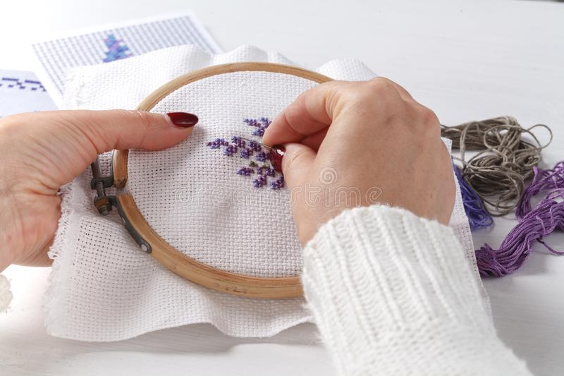 Woman embroidering cross lavender royalty free stock photos