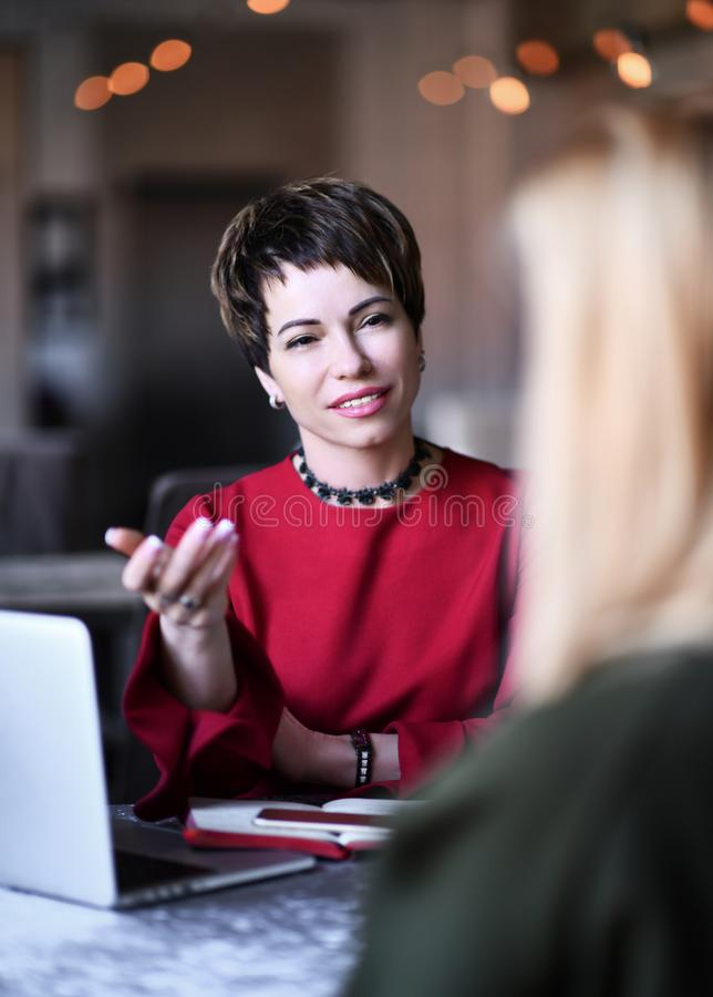 Woman with emotional  problems  visiting psychiatrist female doctor for consultation stock photos