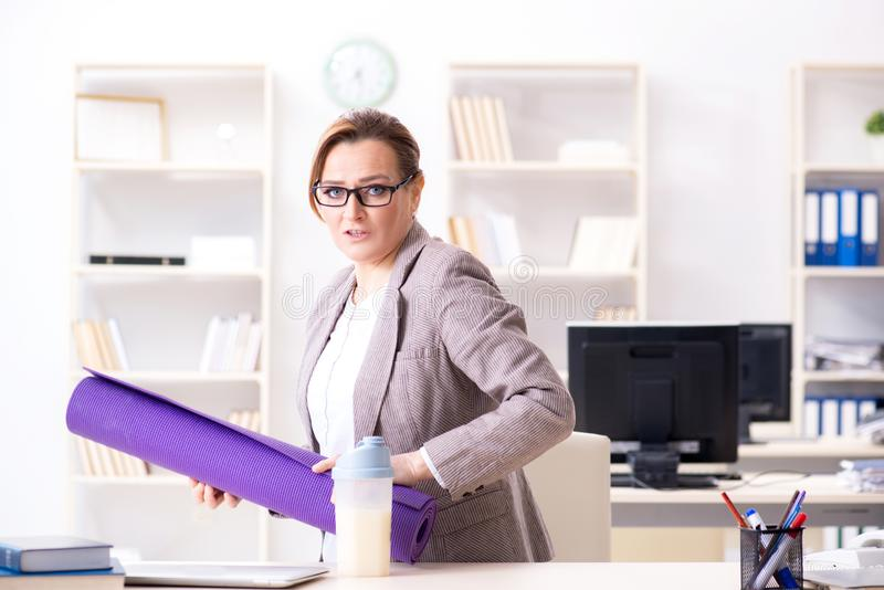 The woman employee going to sports from work during lunch break stock photo