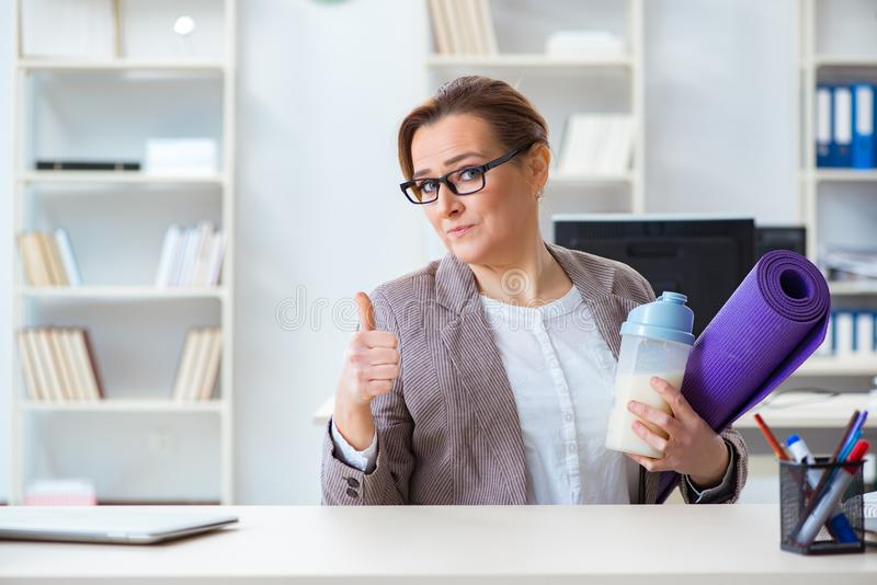 The woman employee going to sports from work during lunch break. Woman employee going to sports from work during lunch break stock photos