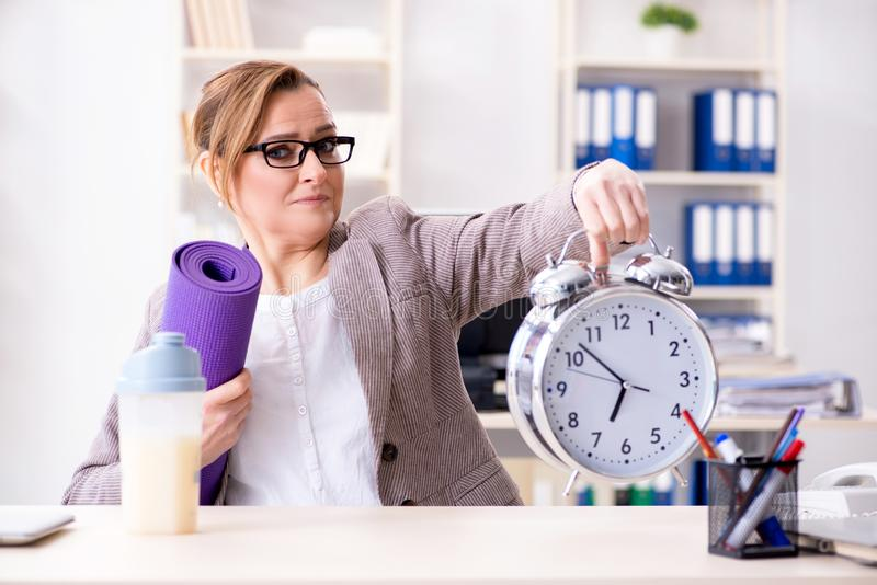 The woman employee going to sports from work during lunch break stock images
