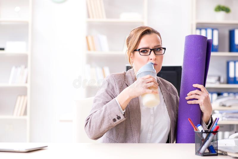 The woman employee going to sports from work during lunch break royalty free stock image