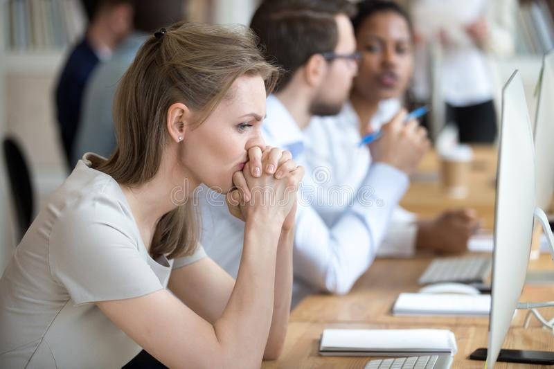 Woman employee having problem and doubts about business moments royalty free stock photo