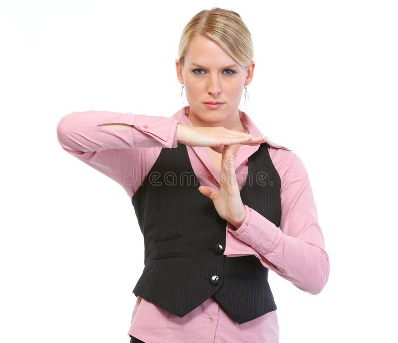 Woman employee showing break gesture stock photos