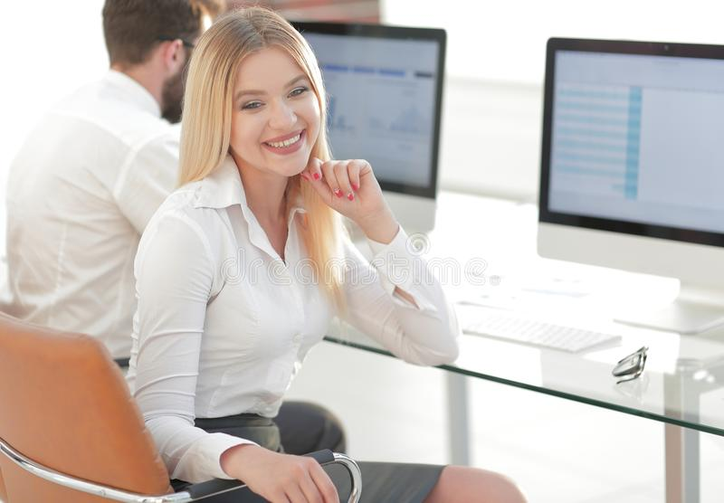 Woman employee sitting at a Desk in the office. Photo with copy space royalty free stock images