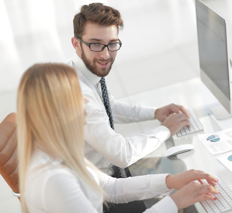 Woman employee sitting at a Desk in the office. Photo with copy space royalty free stock image