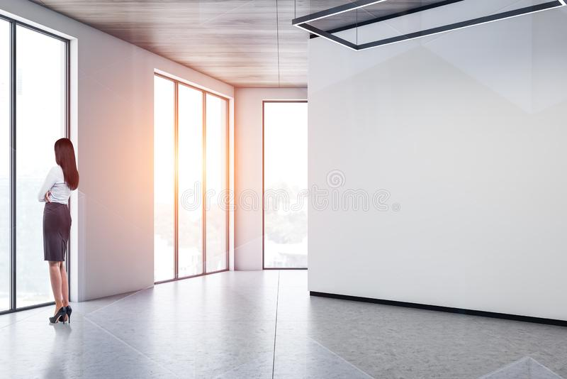Woman in empty white room royalty free stock images