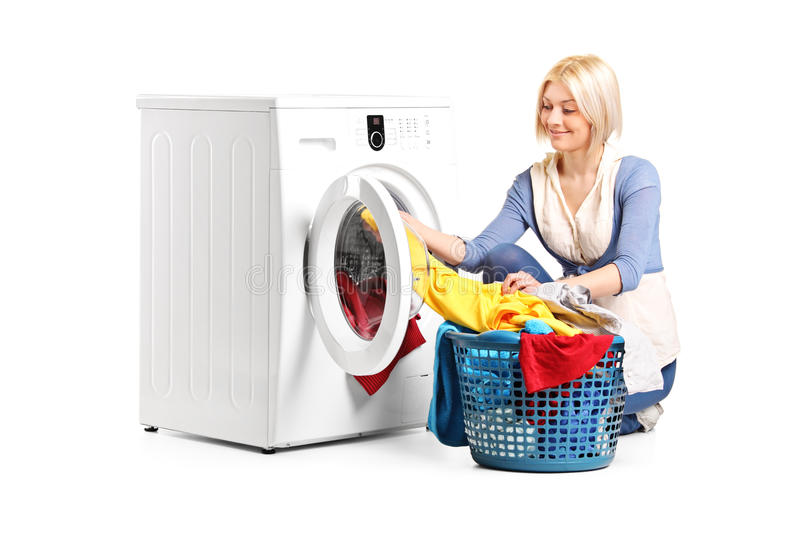 Woman emptying a washing machine royalty free stock images