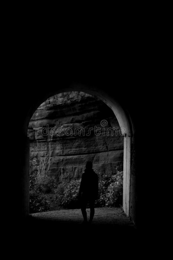 Woman at the end of the tunnel stock photography