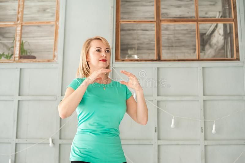 A woman is engaged in Chinese martial art in the studio. Woman and Tai Chi.  stock photos