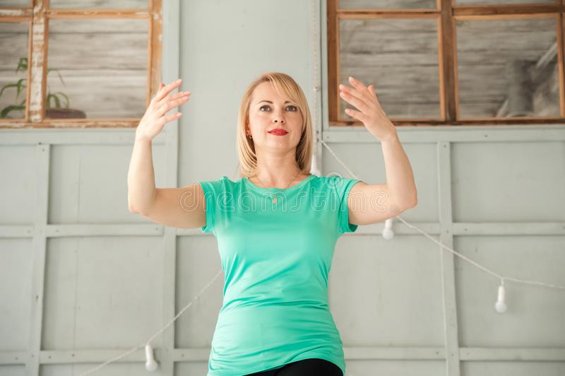 A woman is engaged in Chinese martial art in the studio. Woman and Tai Chi.  stock photography