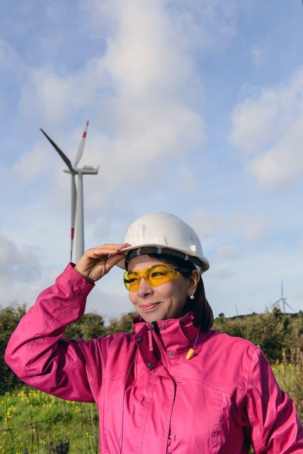 Woman engineer checking wind turbines. stock image