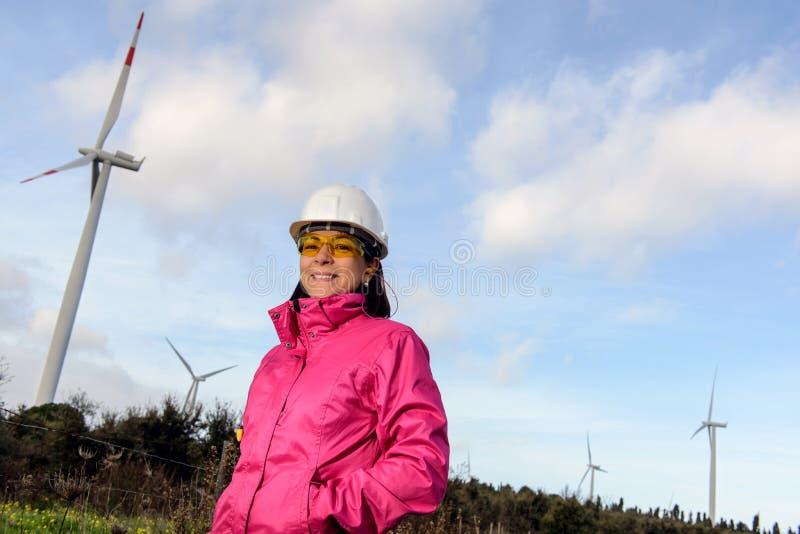 Woman engineer checking wind turbines. stock photo
