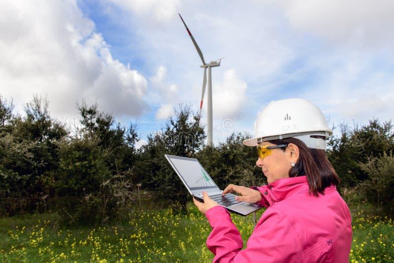 Woman engineer checking wind turbines. royalty free stock photos