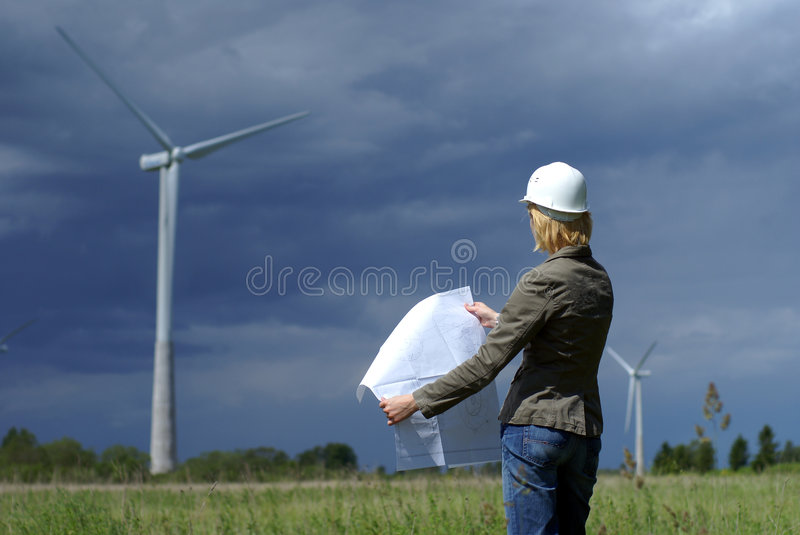 Woman engineer safety hat wind turbines royalty free stock image