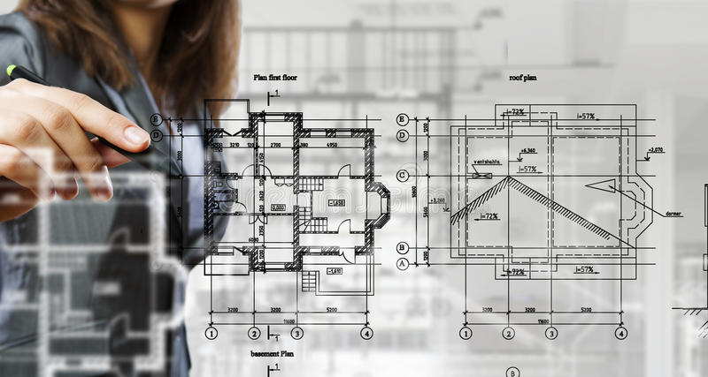 Woman engineer at work . Mixed media. Close of businesswoman drawing construction blueprint on screen . Mixed media royalty free stock images