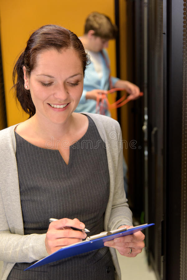 Woman engineer working in datacenter royalty free stock photos