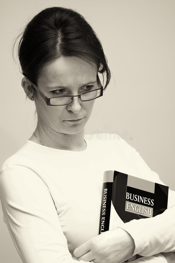 Woman with English book stock images