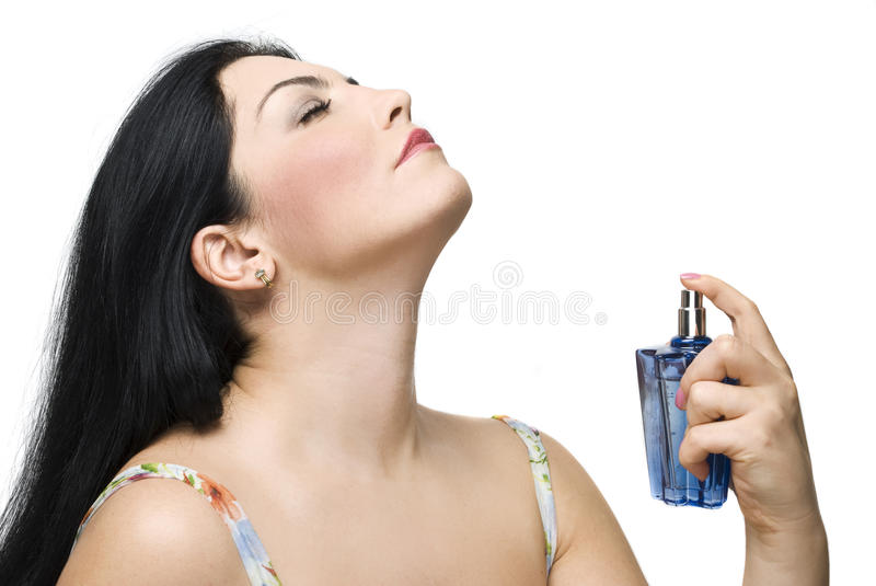 Woman enjoy the fragrance of her perfume royalty free stock photography