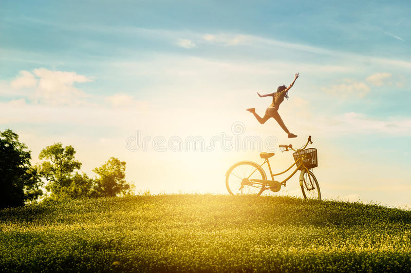 Woman enjoy holiday in the park. She was jumping with happiness. On blue sky background royalty free stock images