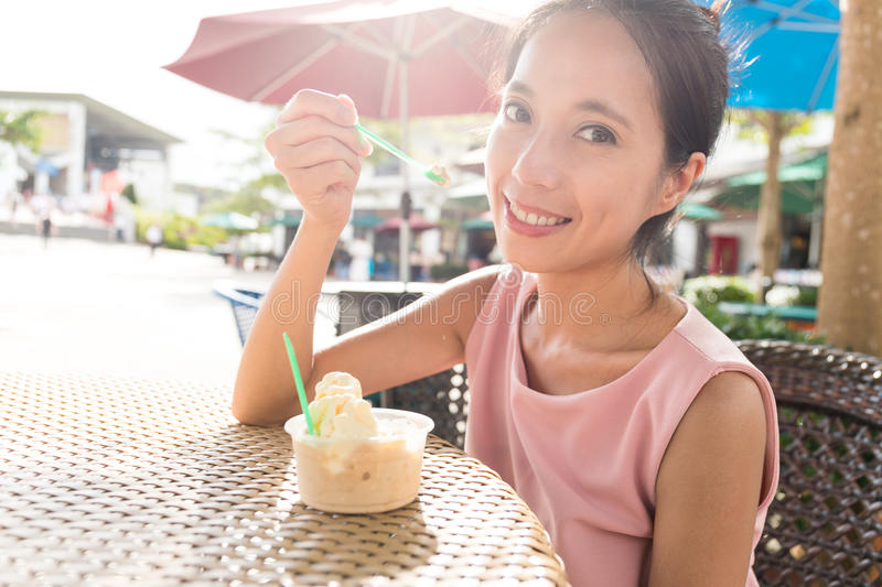Woman enjoy iced cream in summer time royalty free stock photography