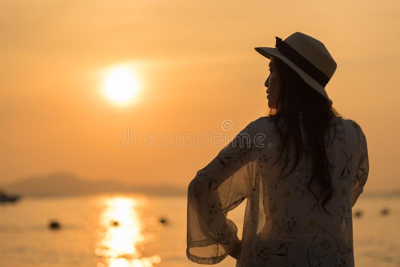 Woman enjoy on sea beach with sunset royalty free stock photos