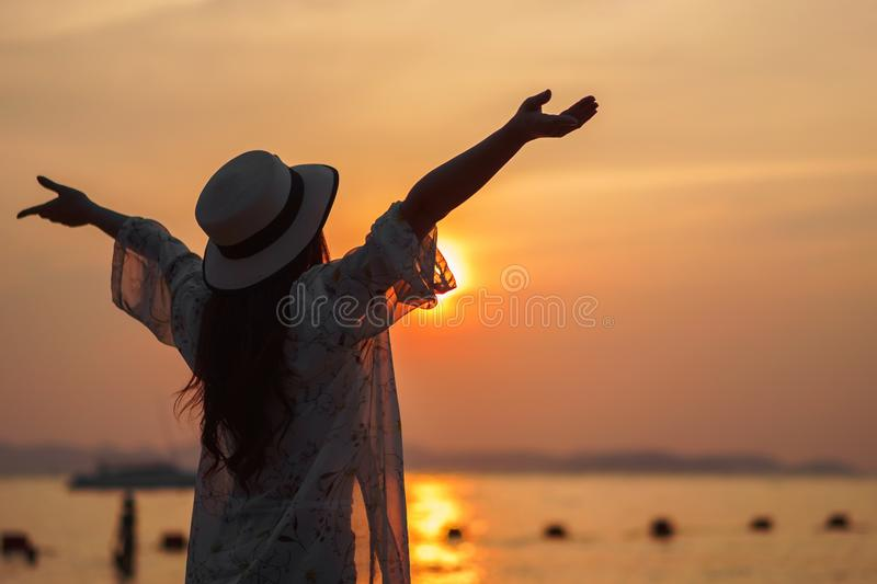 Woman enjoy on sea beach with sunset stock images