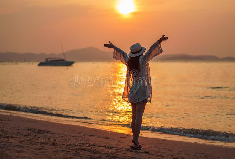 Woman enjoy on sea beach with sunset royalty free stock photo
