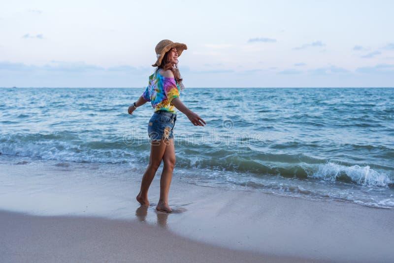 Woman enjoy on sea beach stock photo