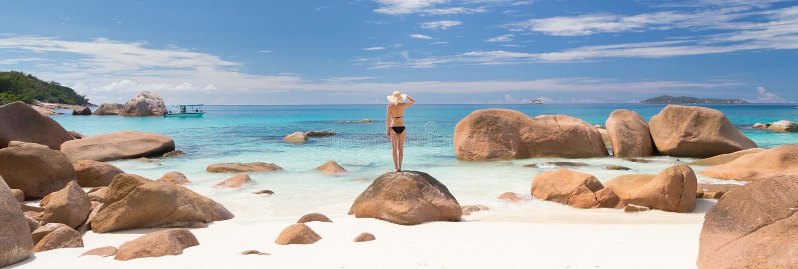 Woman enjoying Anse Lazio picture perfect beach on Praslin Island, Seychelles. royalty free stock images