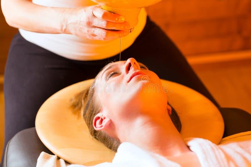 Woman Enjoying A Ayurveda Oil Massage Royalty Free Stock Photo