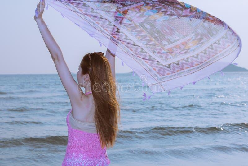 Woman enjoying on the beach. Happy woman enjoying on the beach royalty free stock images