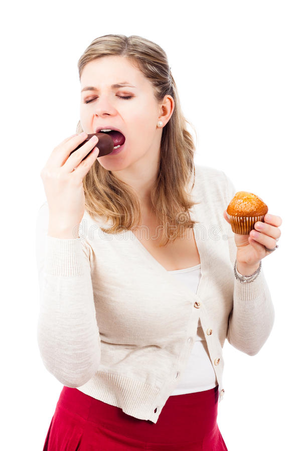 Woman enjoying chocolate donut and muffin stock photos
