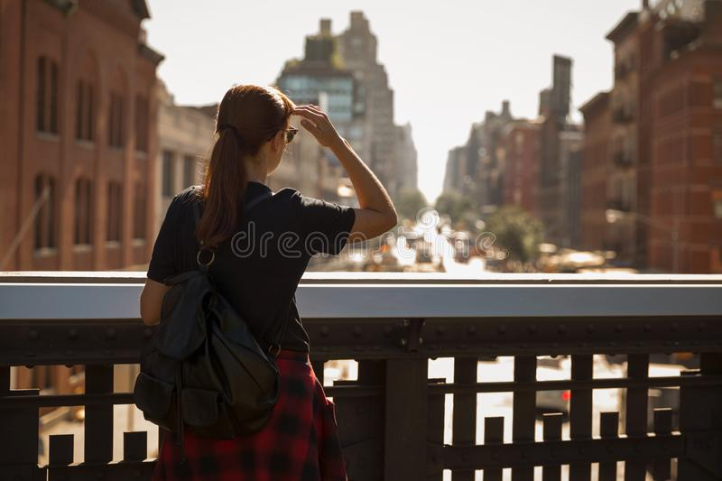 Enjoy the city view. Woman enjoying the city view of Manhattan, NYC stock images
