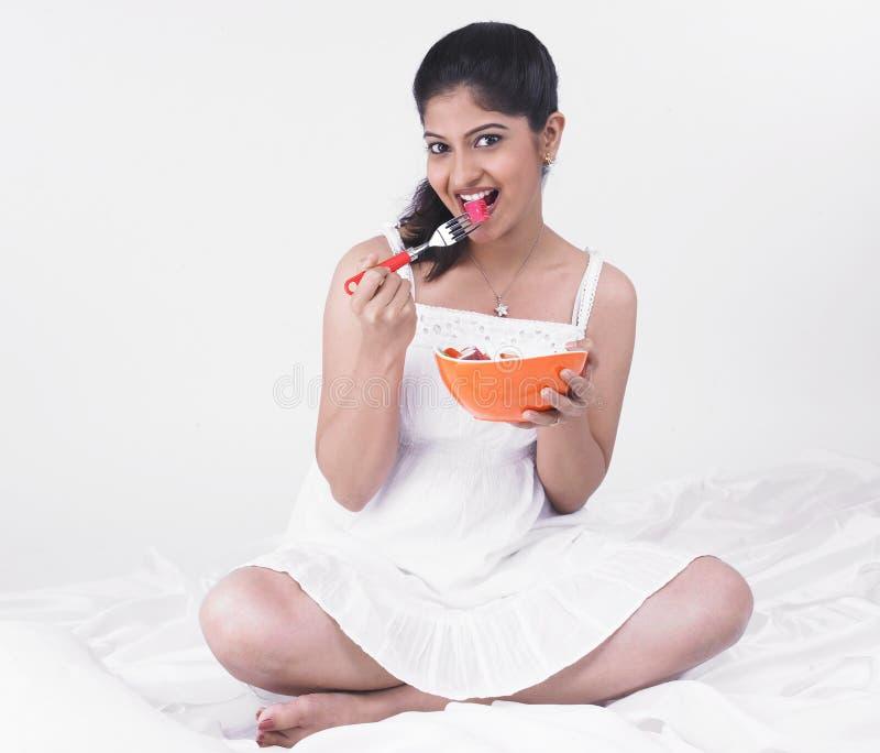 Download Woman enjoying her salad stock image. Image of hair, ethnic - 7387511