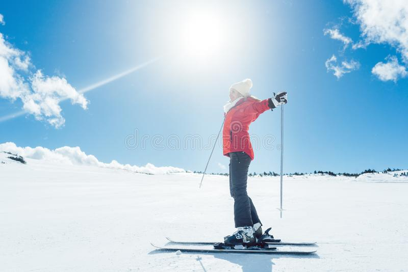 Woman enjoying her winter vacation on ski royalty free stock photography