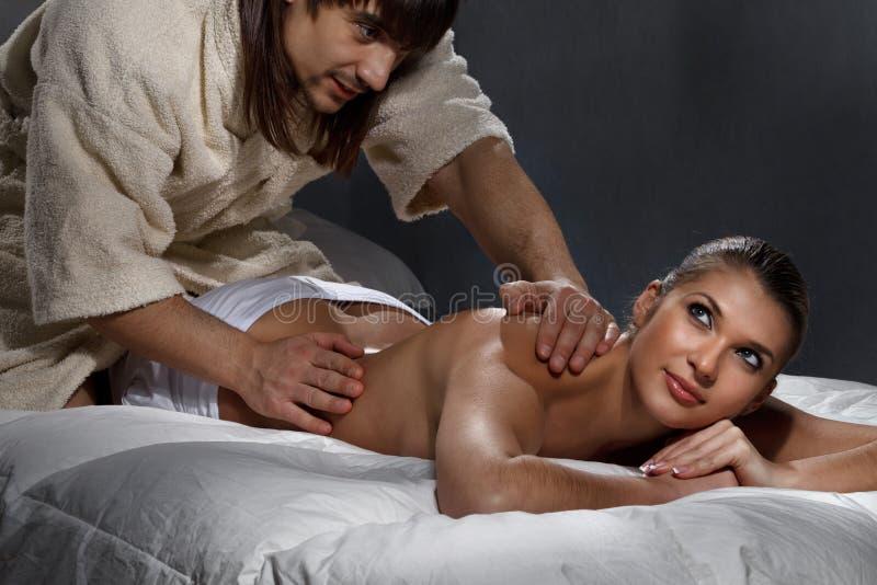 Woman enjoying a massage. Beautiful women enjoying a massage on bed stock photos