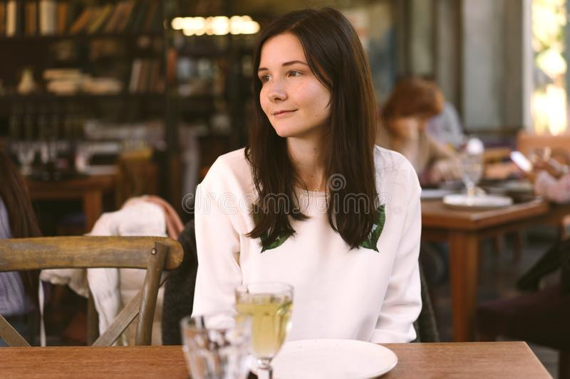 Woman enjoying a meal in a restaurant stock photography