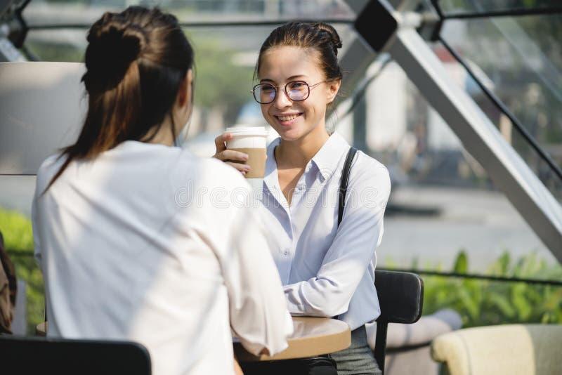 Woman enjoying morning take away coffee stock photo