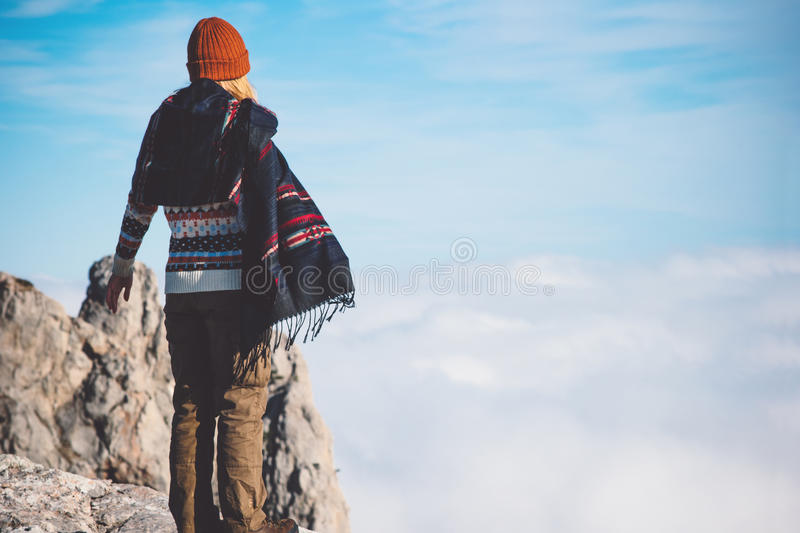 Woman enjoying mountains clouds landscape. Travel Lifestyle concept adventure vacations outdoor wearing scarf and sweater happiness and freedom emotions royalty free stock images