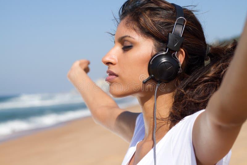Woman enjoying music stock photography