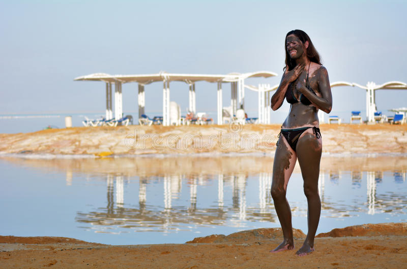 Woman enjoying the natural mineral mud sourced from the Dead Sea. Young woman enjoying the natural mineral mud sourced from the Dead Sea Israel stock photos