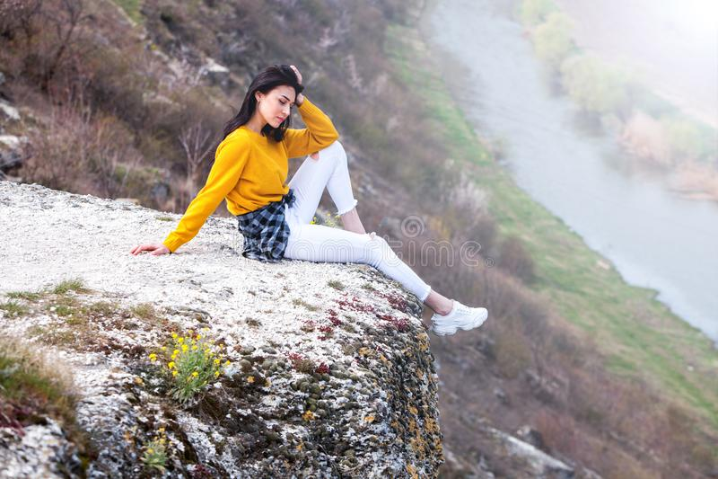 Woman Enjoying Nature. Travel and wanderlust concept Beautiful Young Woman Relaxing outdoors. Nature. Happy traveler girl royalty free stock photography