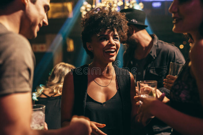 Woman enjoying at nightclub with friends stock photo