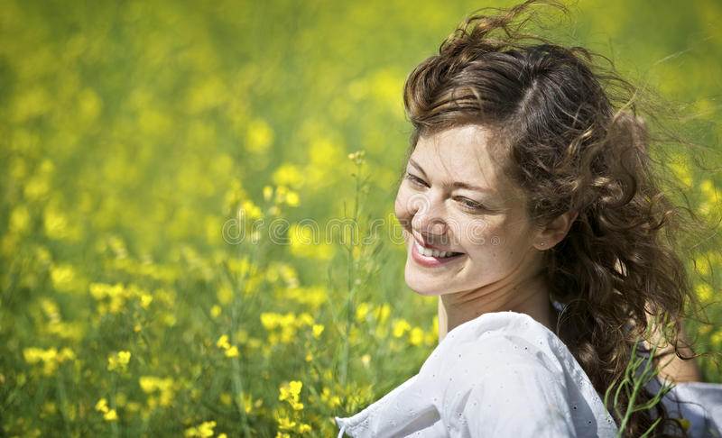 Woman enjoying in rapeseed field stock images