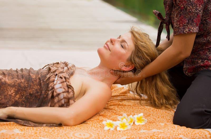 Woman enjoying relaxing neck massage stock image