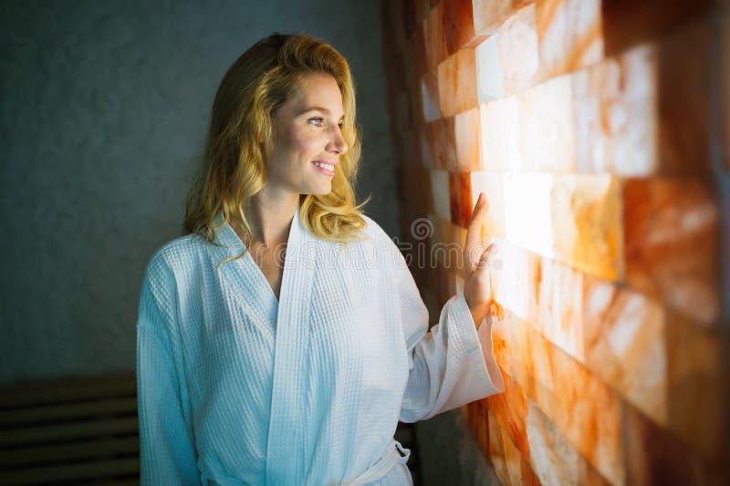 Woman enjoying salt spa treatment royalty free stock image